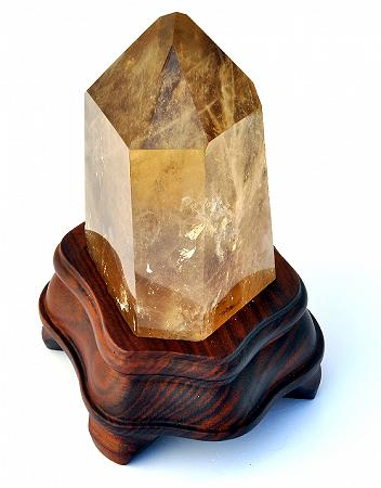 Natural Citrine Point on wooden stand